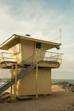 Lifeguard house with surf board Stock Image