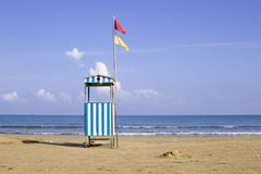 Lifeguard hut. View of an empty beach and lifeguard tower on the Adriatic Royalty Free Stock Photos