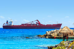 Lifeguard hut and huge container ship on Mexican coast Royalty Free Stock Photo