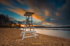 Lifeguard hut on lake shore. Long exposure photo. Lake landscape with lifeguard hut. Long exposure photo with dramatic sky. Polish lake beach on Mazury lake royalty free stock photos