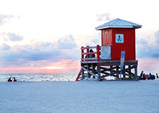 Lifeguard hut on sandy beach. Exterior of red lifeguard hut on sandy beach at sunset, Florida, U.S.A Royalty Free Stock Photos