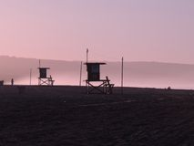 Lifeguard hut silhouettes at dawn Royalty Free Stock Images