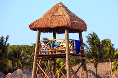 Lifeguard hut. With thatched roof on Mexican shore Royalty Free Stock Photography