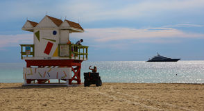 Lifeguard hut and yacht in Miami Beach Royalty Free Stock Photography