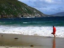Lifeguard on Keem. A lifeguard walking along the beach at Keem, Achill Island, Co. Mayo, Ireland Royalty Free Stock Photography