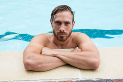 Lifeguard leaning on poolside. Portrait of lifeguard leaning on poolside Royalty Free Stock Photo