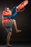 Lifeguard in life vest with ring buoy lifebuoy. Stock Image