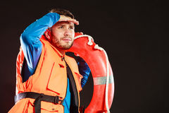 Lifeguard in life vest with ring buoy lifebuoy. Lifeguard man in life vest jacket with ring buoy lifebuoy supervising stock image