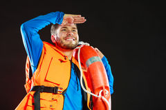 Lifeguard in life vest with ring buoy lifebuoy. royalty free stock images