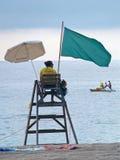 Lifeguard in Lloret de mar, spain. LLORET DE MAR, SPAIN - SEPTEMBER 20, 2012:  A lifeguard watches out the sea on the observatory at the beach of Lloret de Mar Stock Photography