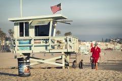 Lifeguard near watch tower on Santa Monica Beach Royalty Free Stock Image