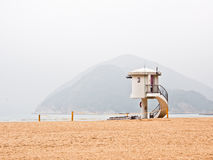 Lifeguard observation tower with mountain background Royalty Free Stock Images