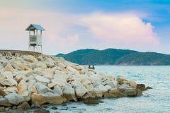 Lifeguard over rock bearer seacoast skyline. Natural coastline background royalty free stock photo