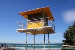 Lifeguard patrol tower. Yellow Lifesaver patrol tower watching over an Australian beach, bright blue sky Stock Photography