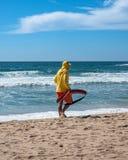 Lifeguard patrolling on a surfing beach