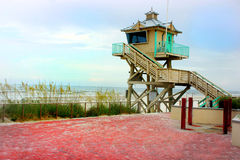 Lifeguard Post. Lifeguard headquarters just right off the sandy beach just steps away from the ocean Royalty Free Stock Photography
