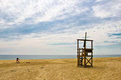 Lifeguard Prepares for Duty on a Cape Cod beach Royalty Free Stock Photo