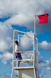 Lifeguard and red flag day at the beach Stock Images