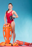 Lifeguard with rescue buoy supervising. Royalty Free Stock Photo