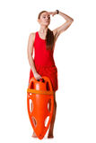 Lifeguard with rescue buoy supervising. Royalty Free Stock Photography