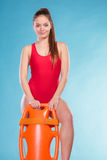 Lifeguard with rescue buoy supervising. Royalty Free Stock Photos