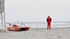 Lifeguard with rescue pedal boats and tower Stock Photos