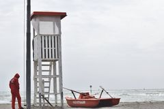Lifeguard with rescue pedal boats and tower Stock Image