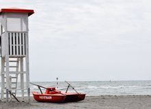 Lifeguard with rescue pedal boats and tower Stock Images