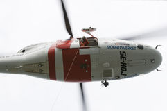 Search and rescue SAR helicopter hovering Stock Photos
