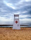 Lifeguard Rescue stand chair at Walnut Beach. A lifeguard rescue stand chair at Walnut Beach in Milford Connecticut on an overcast day at low tide stock photo