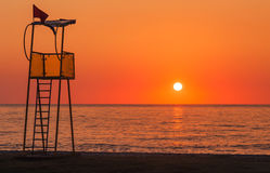Lifeguard rescue tower on beach at sunset. Lifeguard rescue tower on sea beach at sunset royalty free stock images