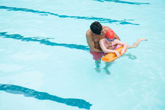 Lifeguard rescuing boy from swimming pool Royalty Free Stock Photography