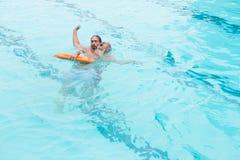 Lifeguard rescuing senior man from swimming pool Royalty Free Stock Photo