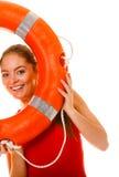 Lifeguard with ring buoy having fun. Royalty Free Stock Photos