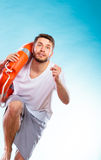 Lifeguard running with equipment Royalty Free Stock Photography