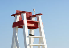 Lifeguard's seat against blue sky. An empty wooden beach lifeguard's seat at the beach against a blue sky royalty free stock photos
