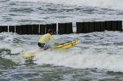 LIFEGUARD. SEACOAST, BALTIC SEA - POLAND: Lifeguard during water training Royalty Free Stock Images