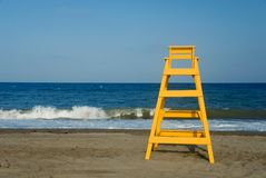 Lifeguard seat. Yellow baywatch chair in front of the sea Royalty Free Stock Images