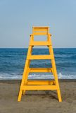 Lifeguard seat. Yellow baywatch chair in front of the sea Royalty Free Stock Photography