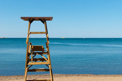 Lifeguard seat. Leafeguard seat watching over beautifully sunny Mediterranean royalty free stock photos