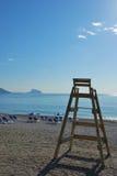 Lifeguard seat. A lifeguard high chair on a quiet beach Stock Image
