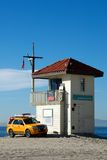 Lifeguard shack and yellow pick up truck Royalty Free Stock Photography