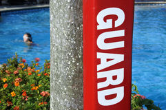 Lifeguard sign in a resort pool Stock Image