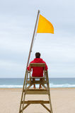 Lifeguard sitting in his chair. Watching the sea royalty free stock photography