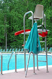 LifeGuard Stand. Life guard station with umbrella and floats at a family pool royalty free stock photography