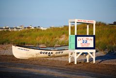 Lifeguard Stand and Boat on the Beach Stock Photo