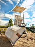 Lifeguard stand and row boat Royalty Free Stock Photography