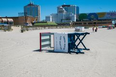 A lifeguard stand was seen on its side on the sand on a deserted Atlantic City Beach. Resorts and Hard Rock casinos are seen in. Atlantic City, New Jersey - May stock image