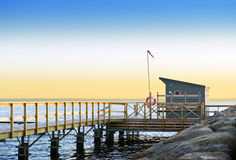 Lifeguard station. And pier on a tranquil evening on the south coast of Sweden, looking out towards Denmark royalty free stock photography