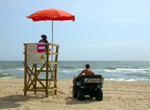 Lifeguard station. Two lifeguards at a station in virginia beach royalty free stock photography